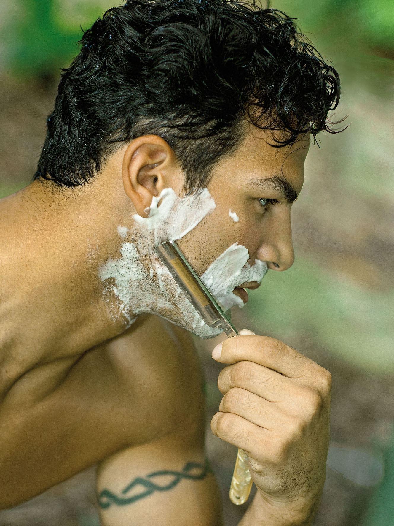 Man at his daily shaving ritual
